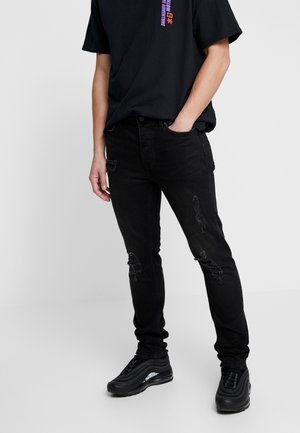 MULTI RIP - Jeans Skinny Fit - washed black