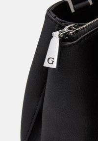 Guess - AMBROSE TURNLOCK SATCHEL - Handtasche - black - 3