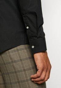 Calvin Klein Tailored - STRETCH SLIM - Chemise classique - black - 5