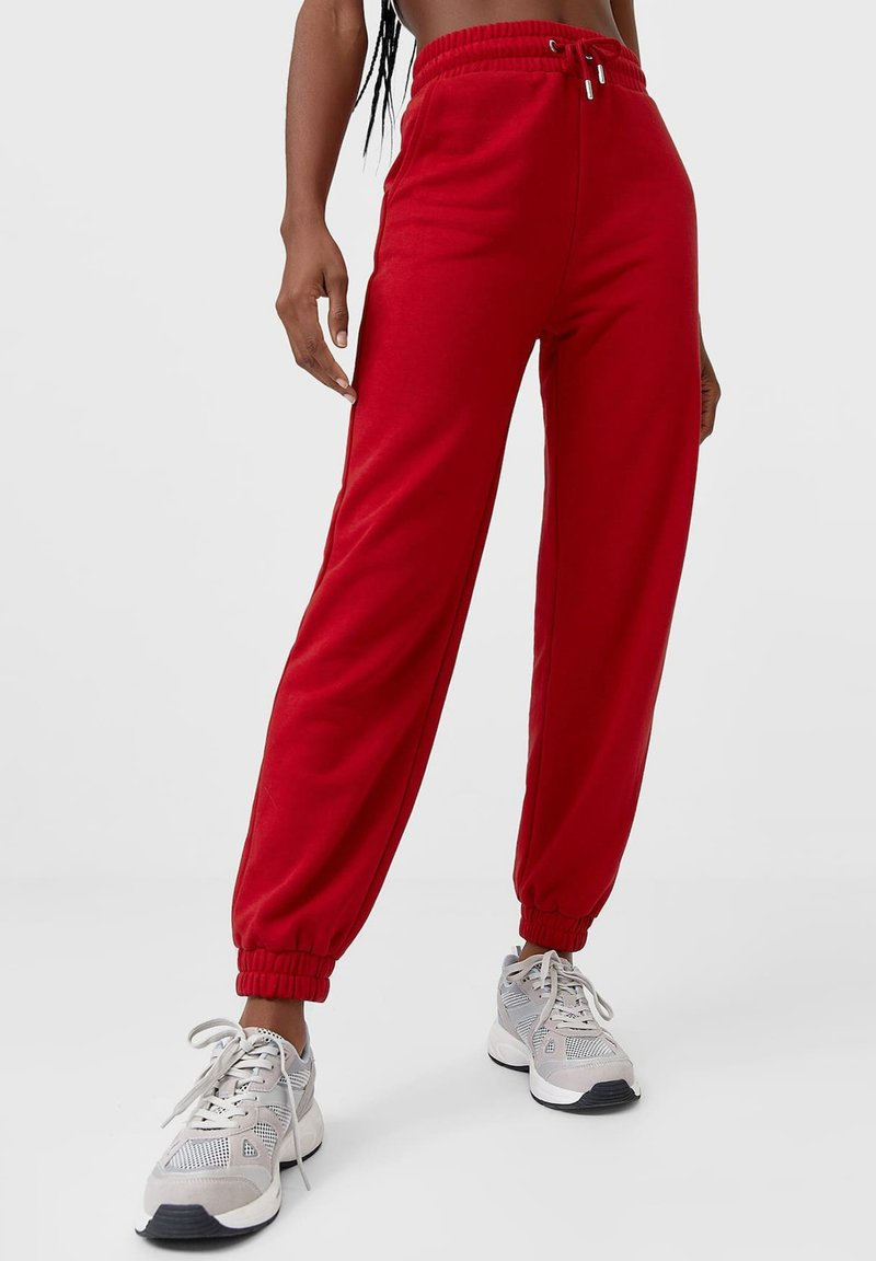 Stradivarius - Tracksuit bottoms - red