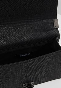 Gina Tricot - MIA BAG - Across body bag - mottled black - 4