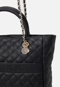 Guess - ILLY ELITE TOTE - Handbag - black - 3