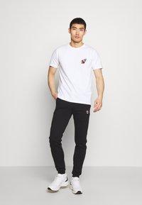 Bricktown - SPACESHIP SMALL - Print T-shirt - white - 1