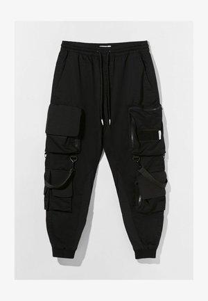 MIT MEHREREN TASCHEN - Spodnie treningowe - black