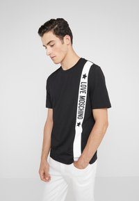Love Moschino - Print T-shirt - black - 0