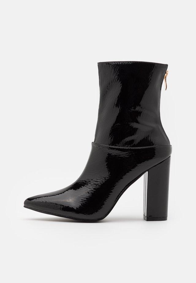 JUNA - Kotníková obuv na vysokém podpatku - black