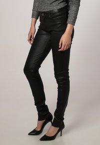 Oakwood - P ANDORA - Leather trousers - black - 2