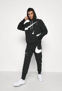 Nike Sportswear - HOODIE - Sudadera - black/(white) - 1