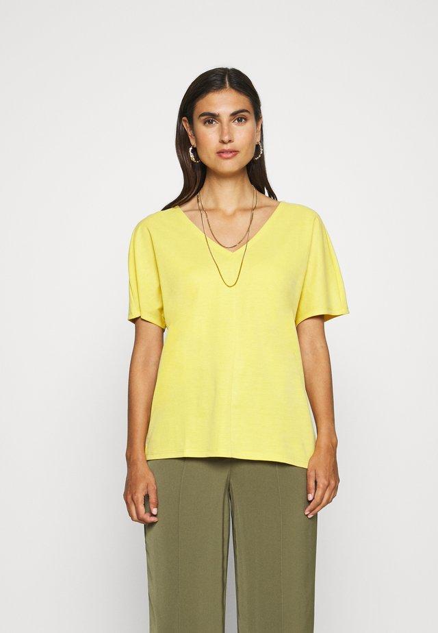 T-shirts basic - goldgelb
