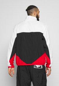 Nike Performance - FLIGHT TRACKSUIT - Tuta - black/white/university red - 2