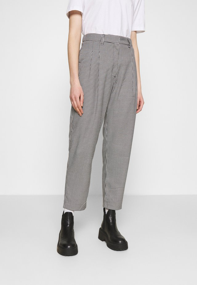 TYRA TROUSERS - Trousers - black/white