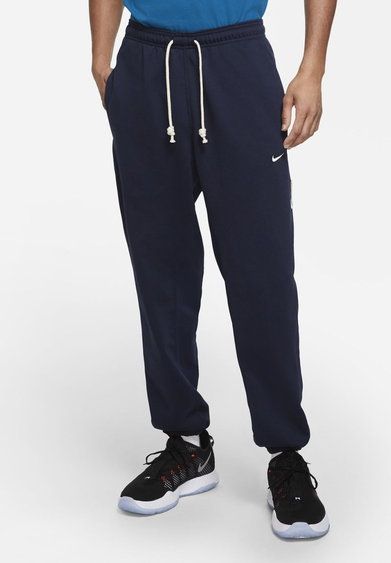 Nike Performance - DF STD ISSUE - Tracksuit bottoms - college navy/pale ivory
