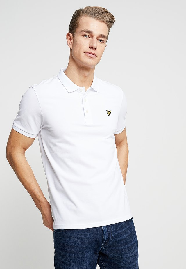 SLIM FIT - Polo - white