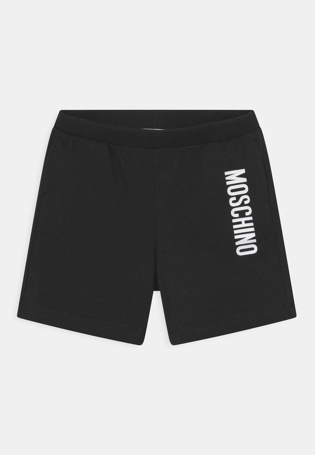 ADDITION UNISEX - Shorts - black