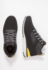 Salomon - UTILITY FREEZE CS WP - Winter boots - black/empire yellow - 1