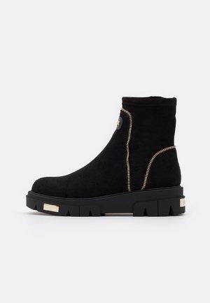 LIZZI  - Platform ankle boots - black