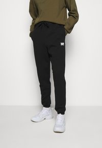 Martin Asbjørn - TRACKPANTS - Pantalon de survêtement - black - 0