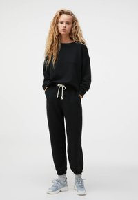 OYSHO - Tracksuit bottoms - black
