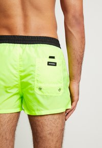 Diesel - SANDY  - Swimming shorts - black/yellow - 2
