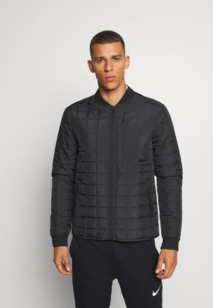 HMLLUKE - Training jacket - black