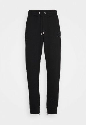 LUX PANTS - Pantaloni sportivi - black