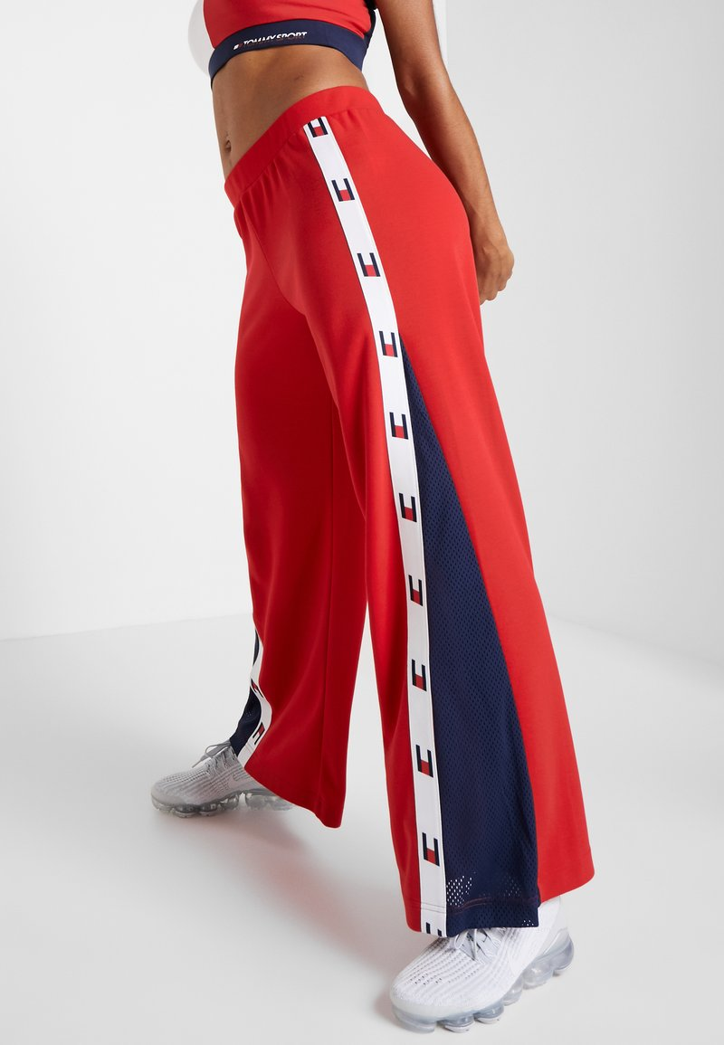 Tommy Sport - FLAG TAPE PANT FLARE - Träningsbyxor - red