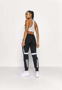 adidas Performance - TRACK PANT - Joggebukse - black/halo silver/white - 2