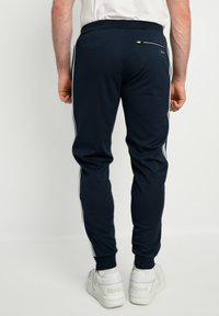 sergio tacchini - YOUNG LINE - Tracksuit bottoms - navy/white - 2