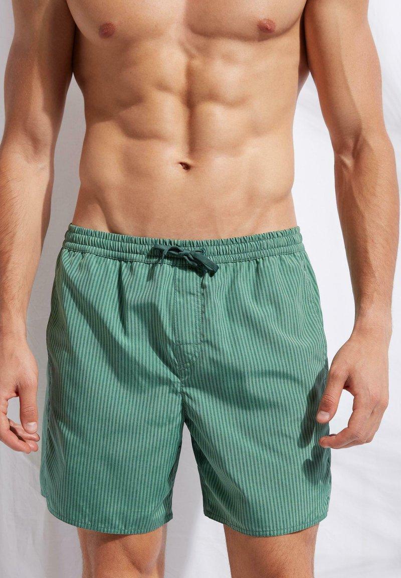 Calzedonia - Swimming shorts - river green