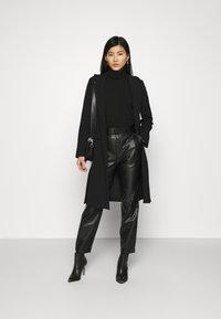NIKKIE - MELLA PANTS - Trousers - black - 1