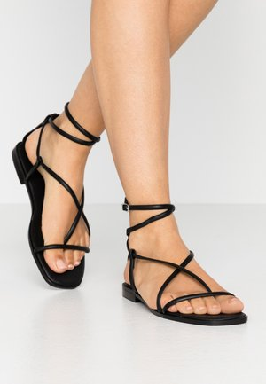 SHELA - T-bar sandals - black