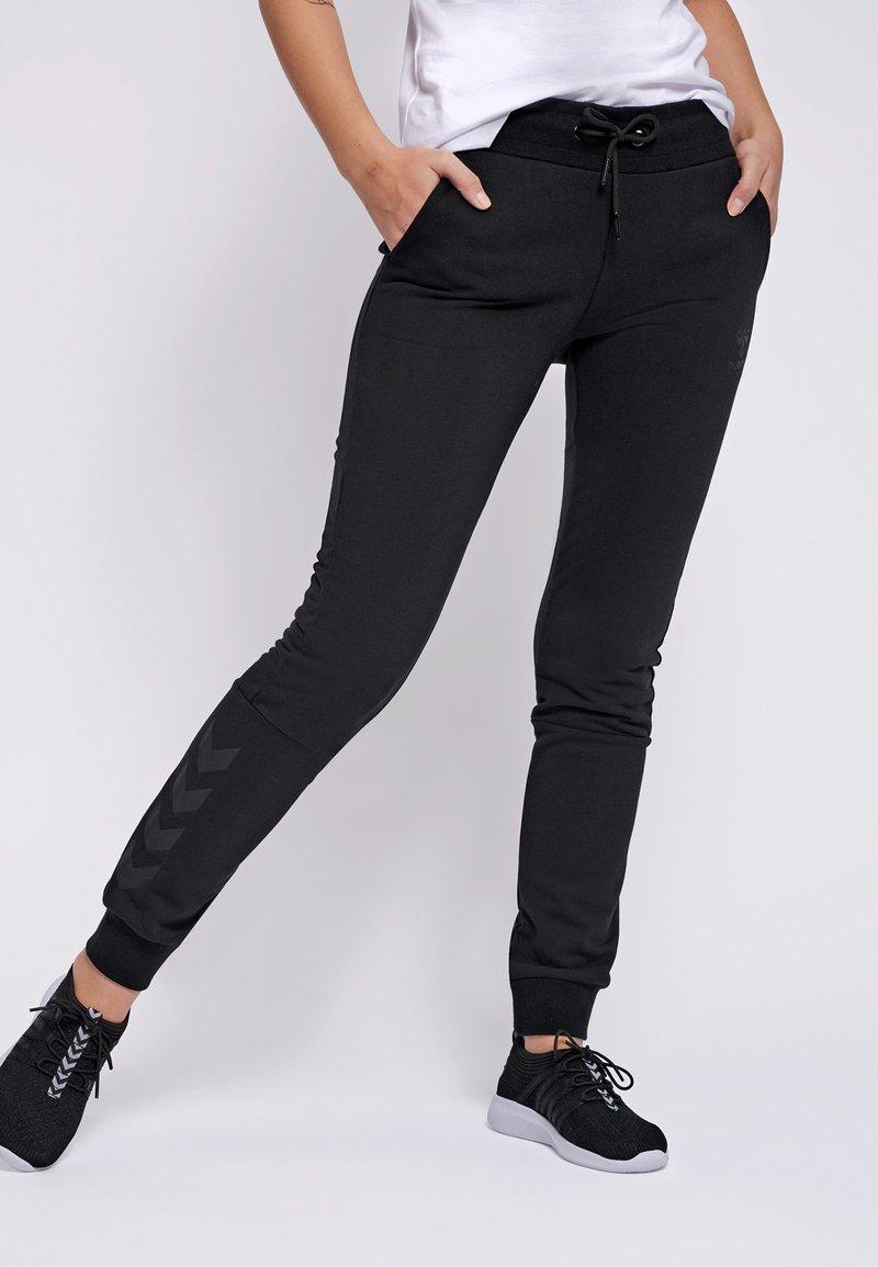 Hummel - Tracksuit bottoms - black