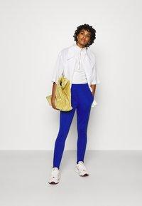 adidas Originals - 70S PANT - Leggings - Trousers - active gold/team royal blue - 1