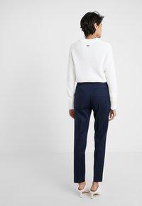 HUGO - HERANI - Trousers - open blue - 2