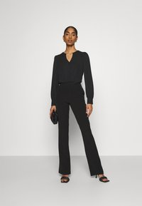 ONLY - ONLELORA ELLY LIFE FLARE PANT - Trousers - black - 1