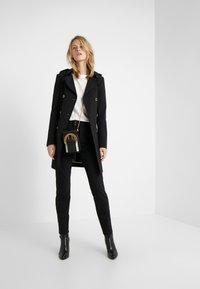 Bogner - LINDY - Spodnie materiałowe - black - 1