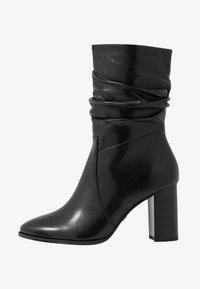 Tamaris - Classic ankle boots - black - 1