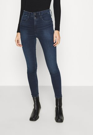 HIGH RISE SUPER SKINNY ANKLE - Jeans Skinny Fit - denim dark