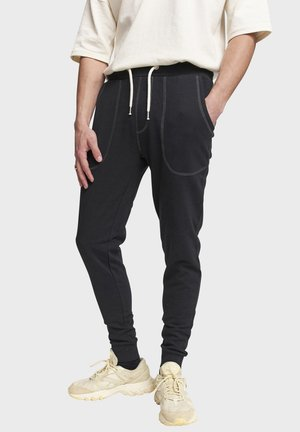DIEGO - Tracksuit bottoms - black