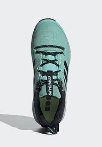 adidas Performance - TERREX TWO FLOW - Fjellsko - acid mint/core black/halo silver - 3