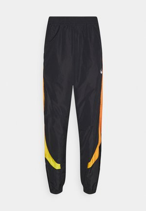 SPRAY UNISEX - Tracksuit bottoms - black