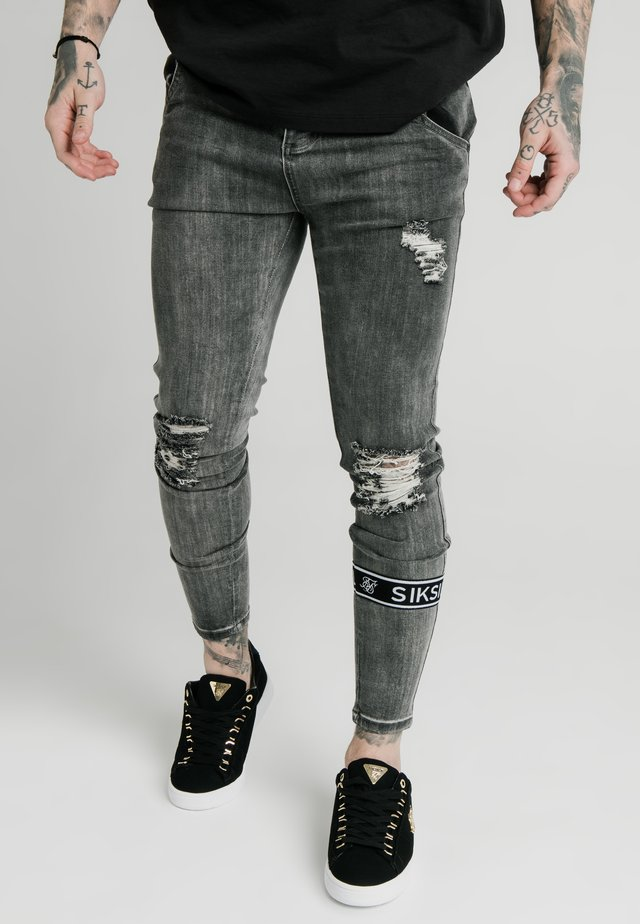 BURST KNEE - Vaqueros pitillo - washed black