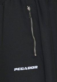 Pegador - VINTO WIDE TRACK PANTS UNISEX - Tracksuit bottoms - black - 8