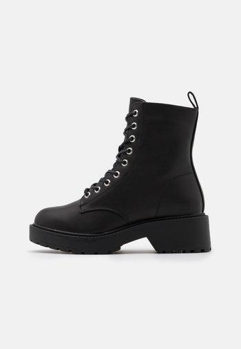 DOTTY - Platform ankle boots - black