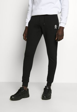 BASIS - Tracksuit bottoms - black