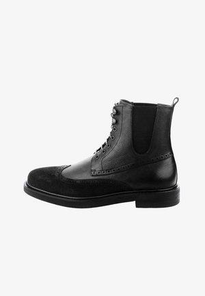 AMANTEA - Cowboy/biker ankle boot - black