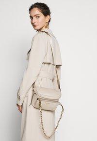 MICHAEL Michael Kors - SLING - Across body bag - light sand - 0