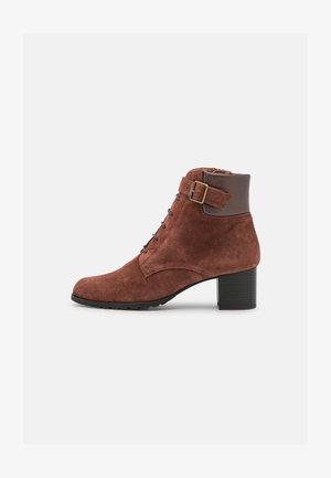 Šněrovací kotníkové boty - cognac/etoile libra