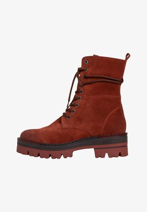 STIEFELETTE - Platform ankle boots - brick