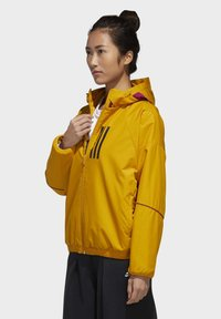 adidas Performance - ADIDAS W.N.D. WARM JACKET - Outdoorjacke - gold - 1